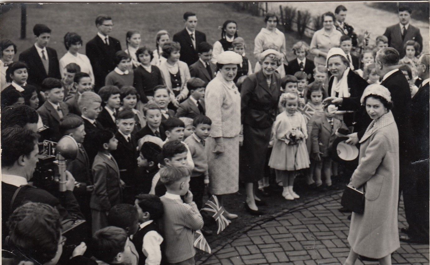 A royal visit: H.M. Queen Elizabeth and The Dutch Queen Juliana shaking hands.