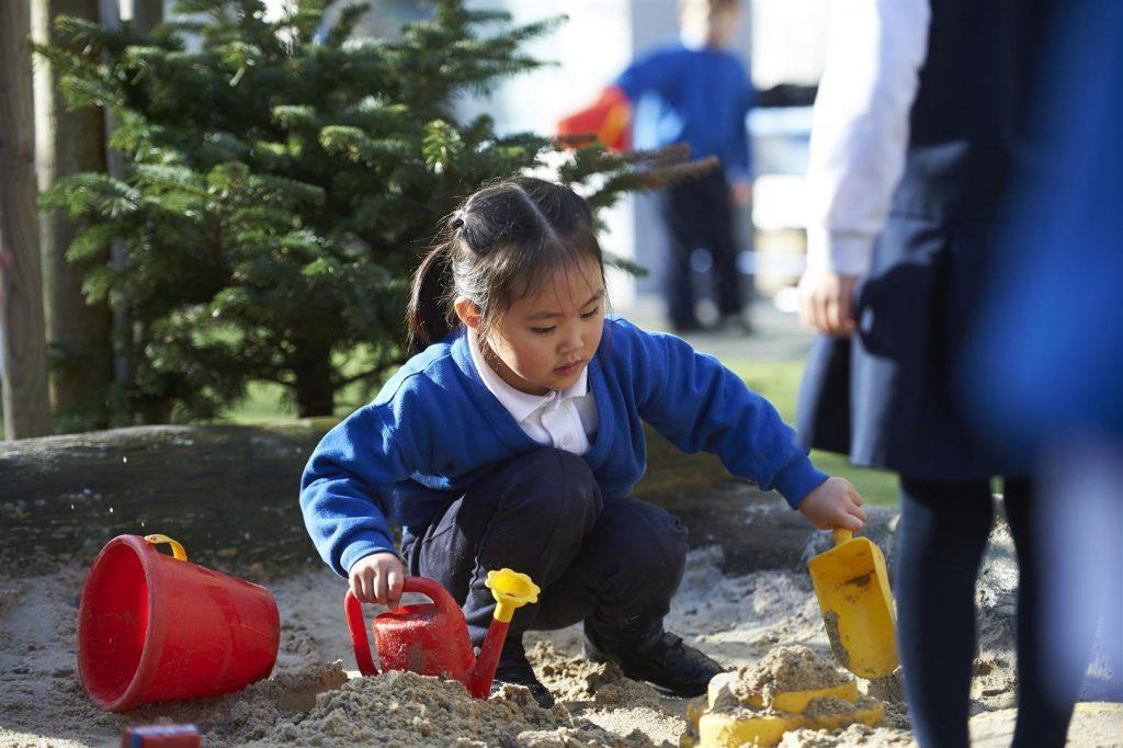 Child playing outdoor at the British International School playground